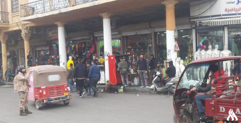 بالصور بغداد..محال تجارية قرب ساحة التظاهر تترقب افتتاح شوارعها